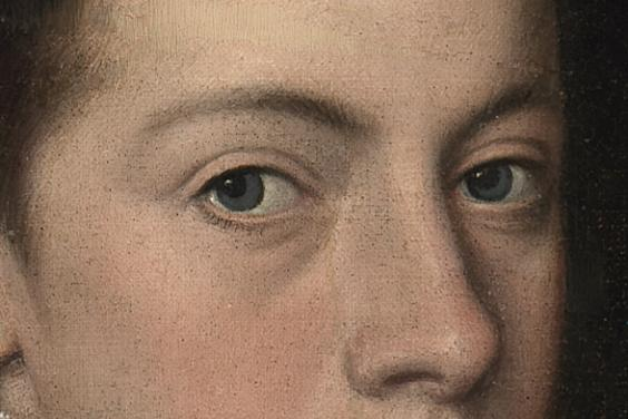 Detail of a painting showing top half of a face