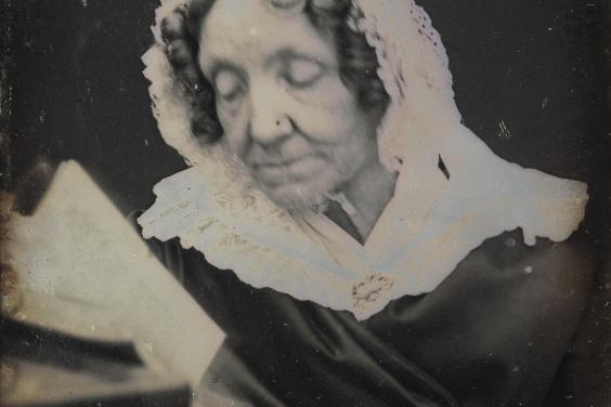 Daguerreotype portrait of a woman reading