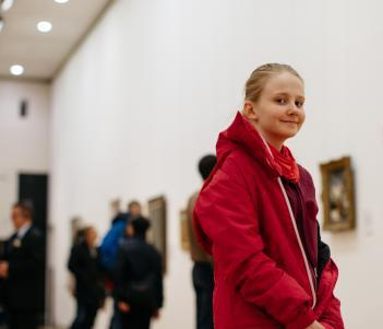 A girl in the exhibition rooms in the Millennium Wing. © National Gallery of Ireland
