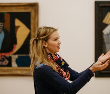 A tour guide speaking in front of a painting by Picasso. © National Gallery of Ireland.