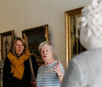 A tour guide speaking about Vera Klute's bust of Gerry Hynes. © National Gallery of Ireland.