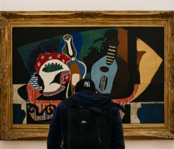 A visitor in front of Picasso's Still Life with a Mandolin. © National Gallery of Ireland.