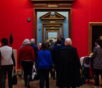 Photo of a group of visitors walking through the Carlo Cambi doorways in the National Gallery of Ireland.