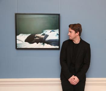 Hennessy Portrait Prize 2017 winner Jack Hickey, pictured in front of his winning painting, 'My Time'. Photograph by Leon Farrell.
