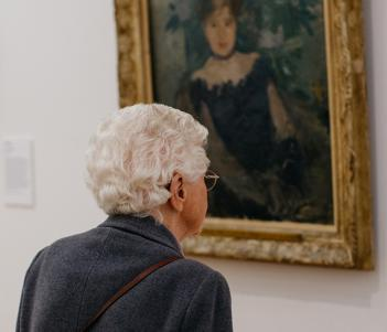 A visitor looking at Berthe Morisot's painting Corsage Noir in the Millennium Wing of the National Gallery of Ireland.