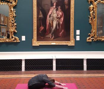 A yoga class taking place in the Grand Gallery of the National Gallery of Ireland.